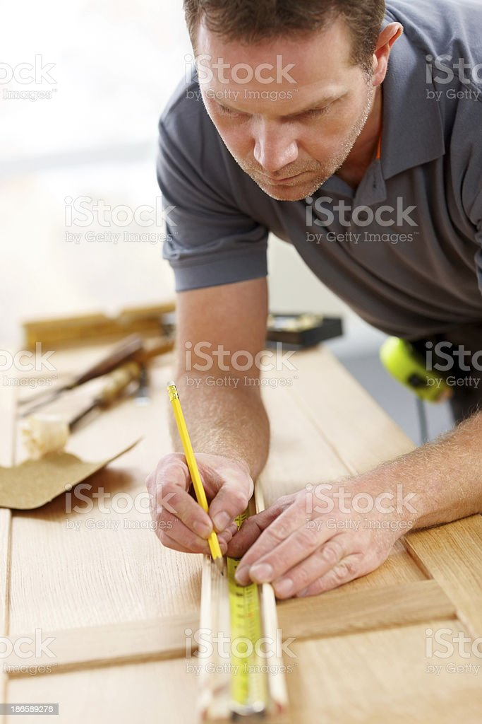 Carpenter marking a measurement royalty-free stock photo
