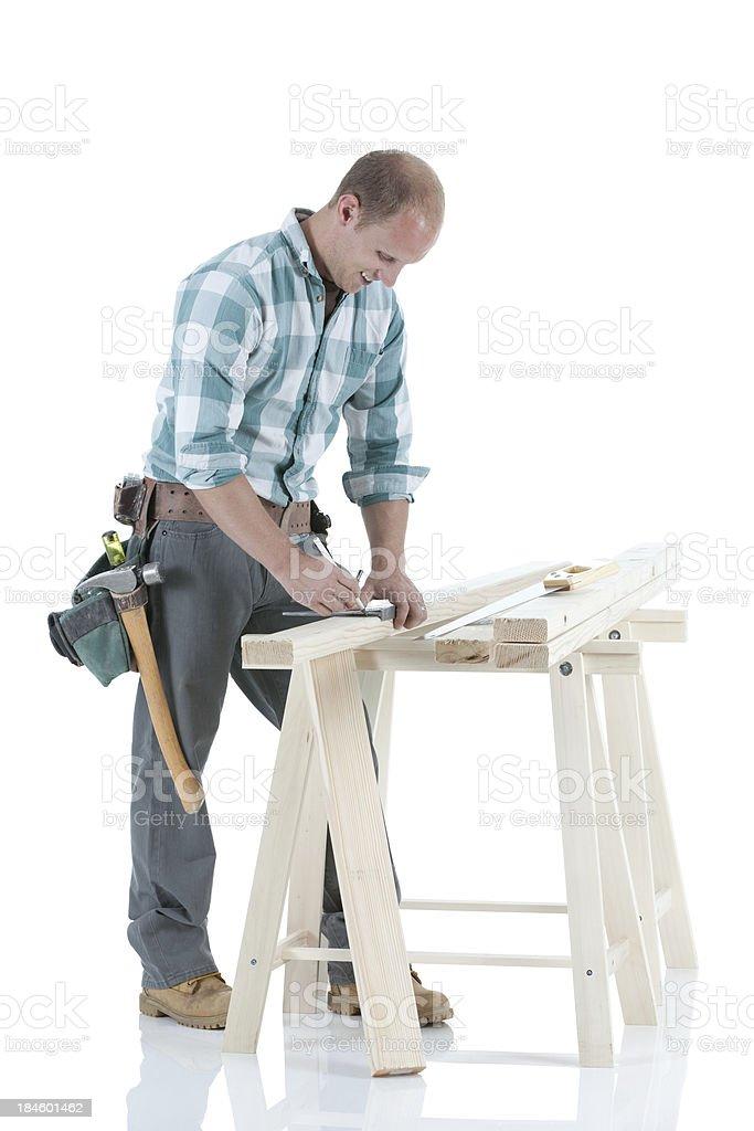 Carpenter marking a wooden plank stock photo