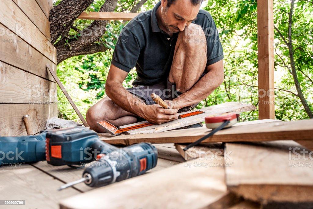 Carpenter Marking on Wooden Plank stock photo