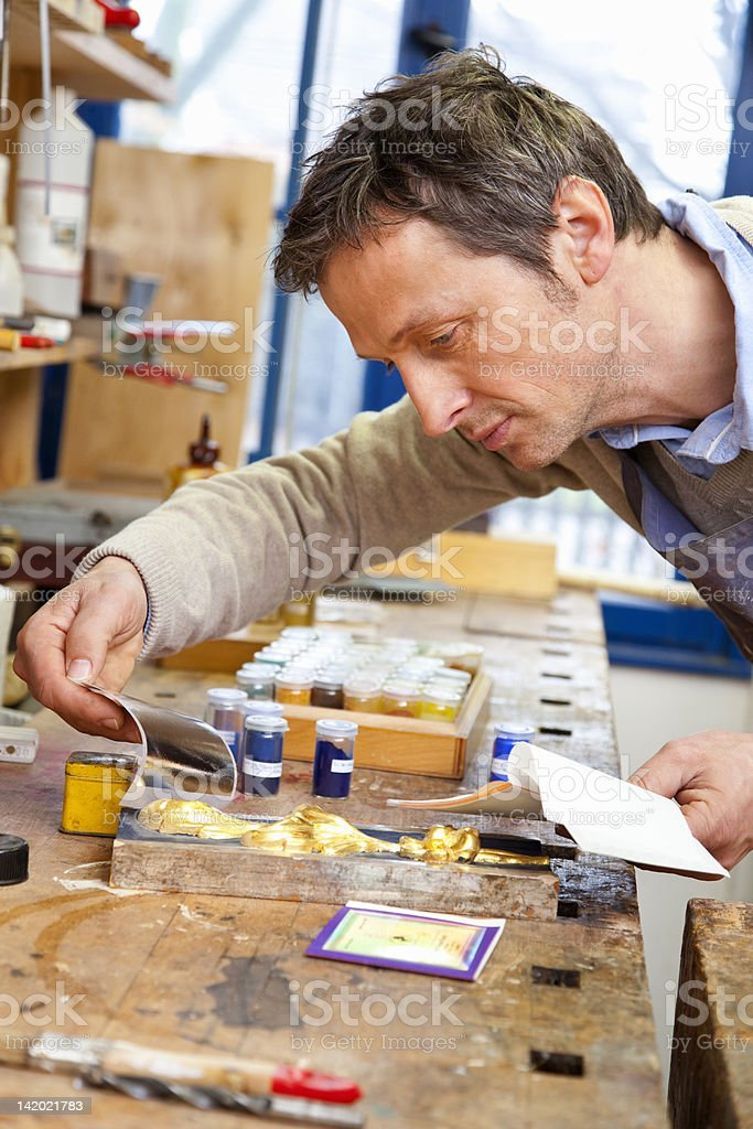 Carpenter matching pigment to paint stock photo