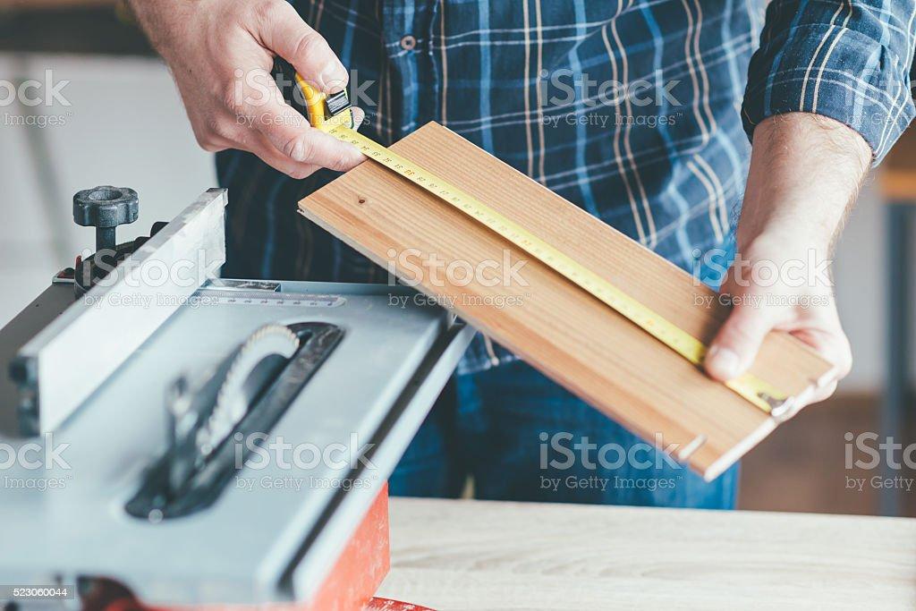Carpenter measure stock photo