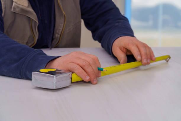 Carpenter measuring laminate counter top for cut kitchen remodel picture id1095170054?b=1&k=6&m=1095170054&s=612x612&w=0&h=ewc3wetefnvhhwl4t4a1ad61yaie xhzg9p7iqtbtgy=