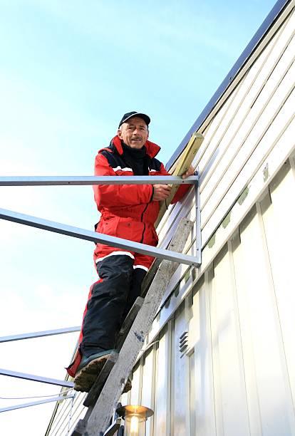 Carpenter on a ladder stock photo
