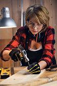 Portrait of beautiful female carpenter at work