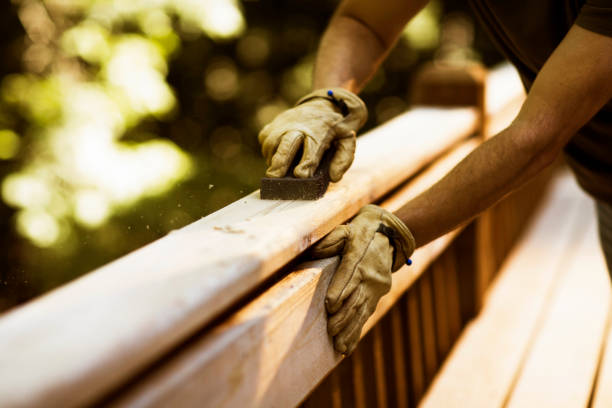 Carpenter Sanding Cedar Deck stock photo