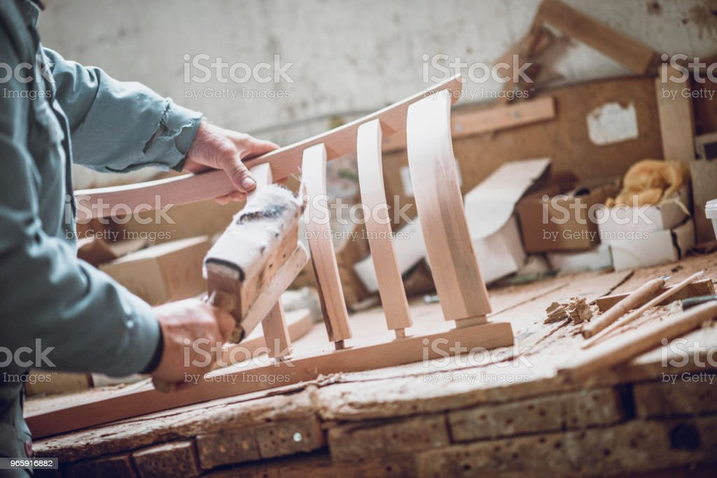 Carpenter Sanding The New Chair He Made - Royalty-free Art And Craft Stock Photo