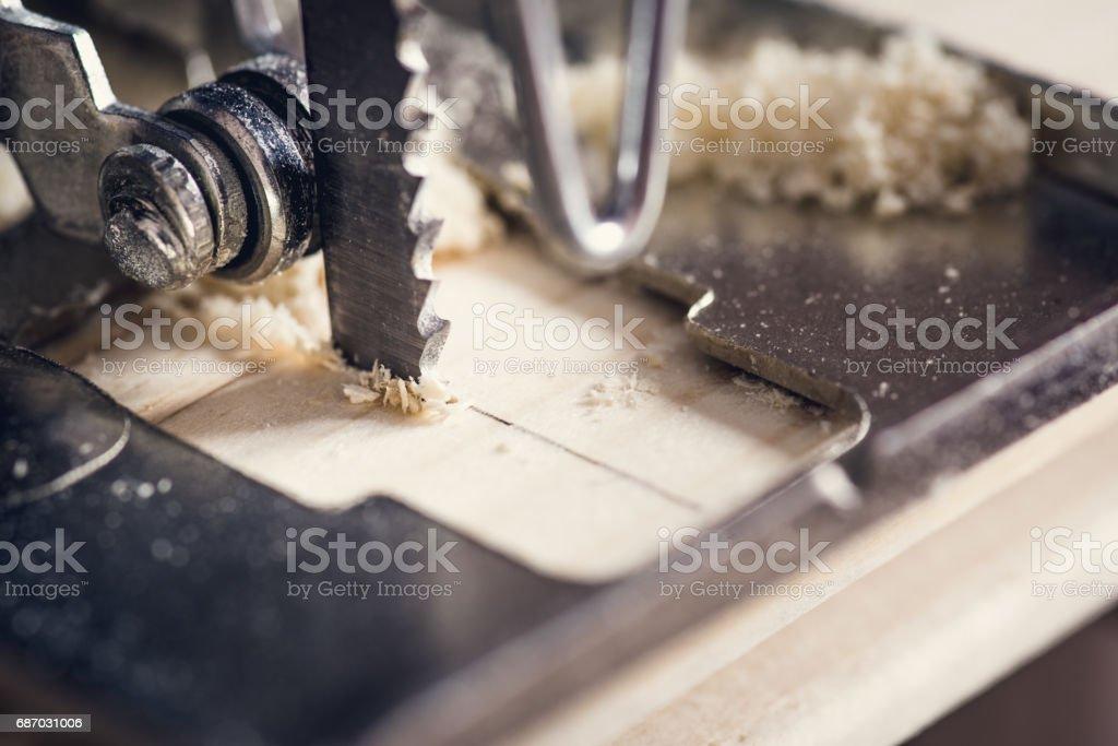 Carpenter sawing wood stock photo