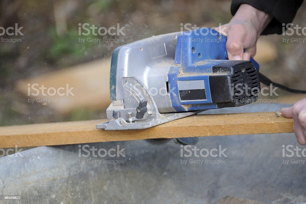 Carpenter Sawing Wood royalty-free stock photo