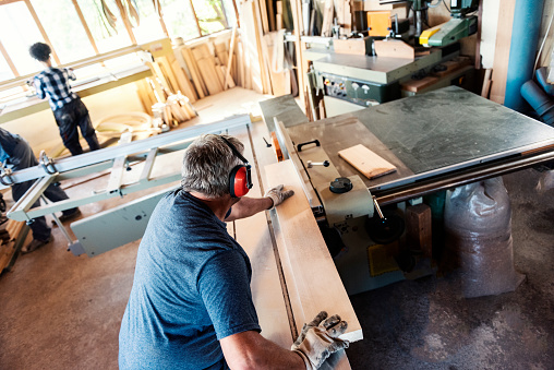 Carpenter Sawing Wooden Planks Stock Photo - Download Image Now