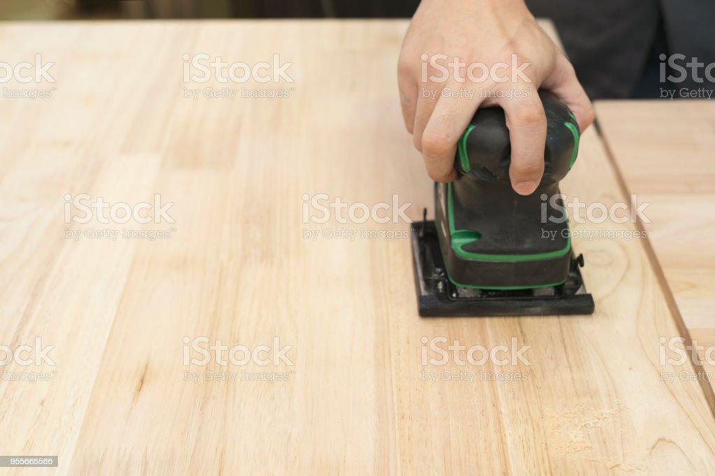 Carpenter Scrubbing Wood Board In The Workshop Diy And Repair