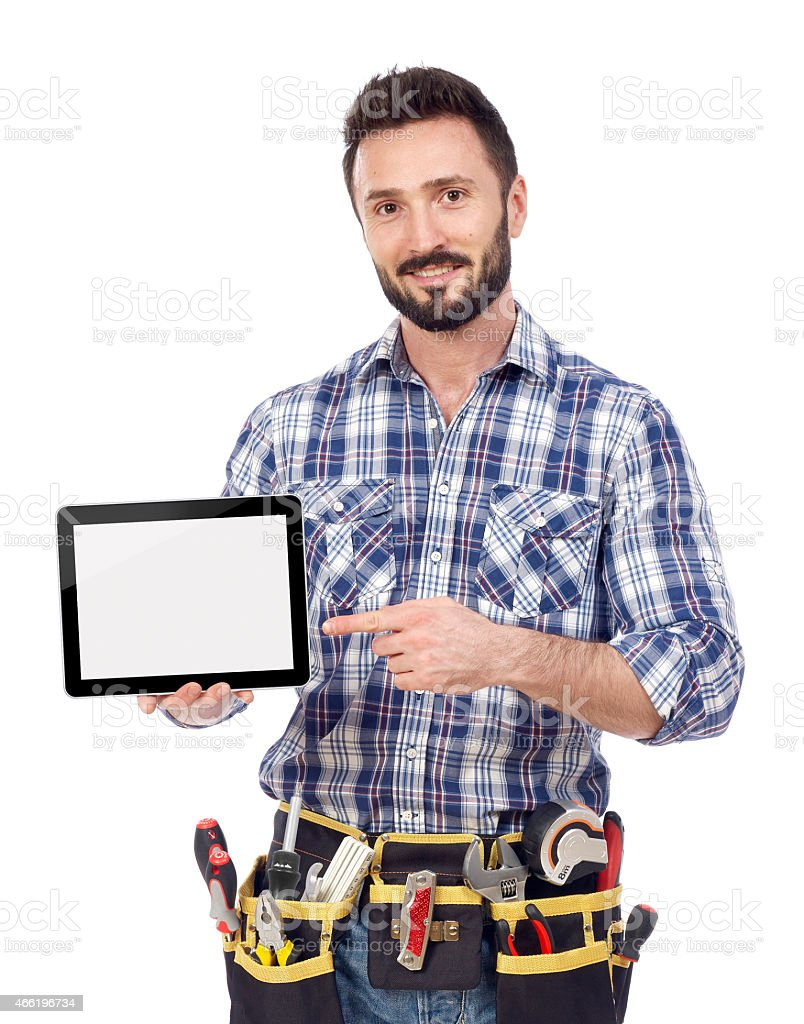 Carpenter showing tablet stock photo