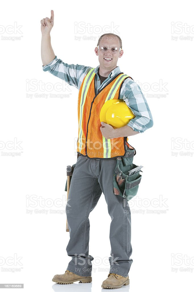 Carpenter standing with finger raised royalty-free stock photo