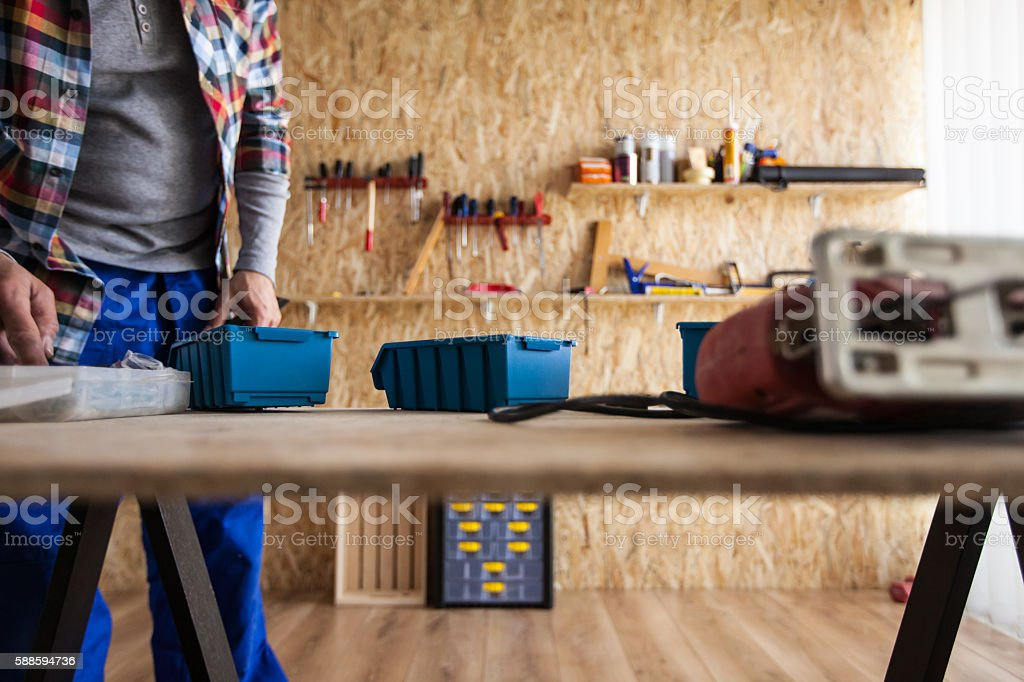 Carpenter stands in his workshop stock photo