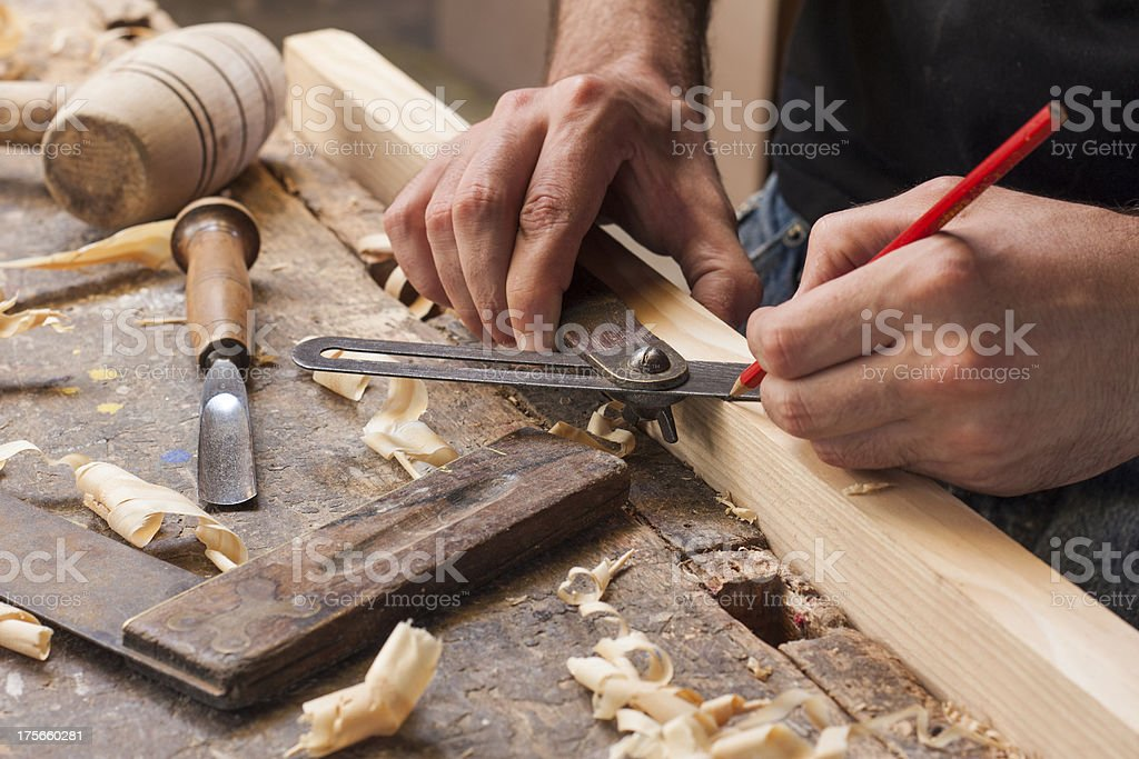 carpenter taking measurement stock photo