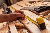 istock carpenter taking measurement 481628382