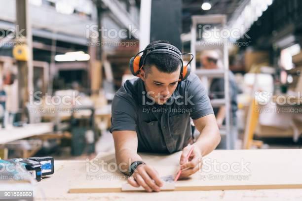 Carpenter Taking Measurements Stock Photo - Download Image Now