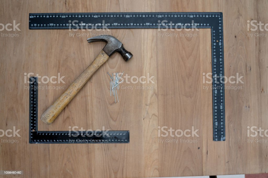 Carpenter Tools On A Wooden Background Stock Photo More Pictures
