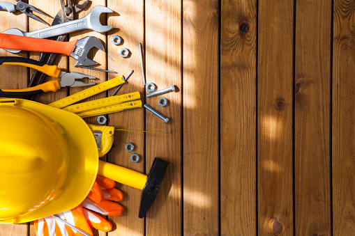 Carpenter tools on wooden background
