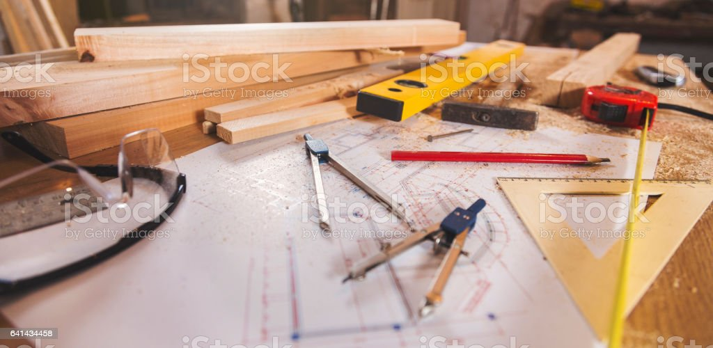 Carpenter tools on wooden background royalty-free stock photo