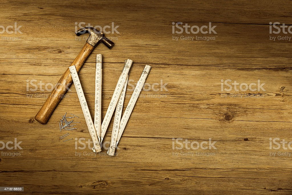 Carpenter tools on wooden surface royalty-free stock photo