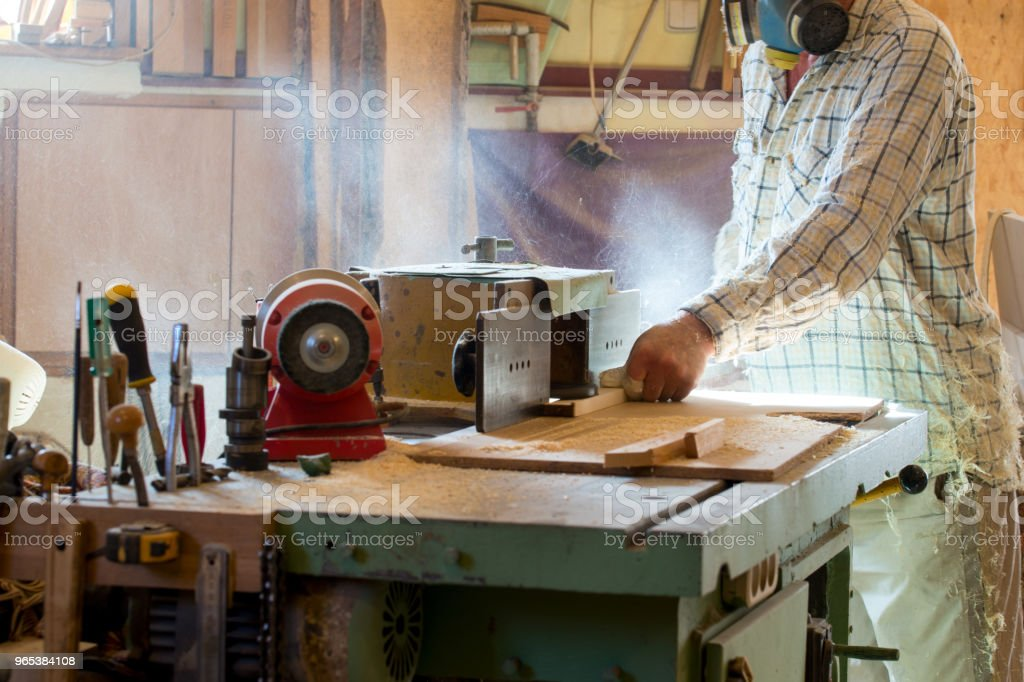 Carpenter tools on wooden table with sawdust. Circular Saw. Cutting a wooden plank royalty-free stock photo