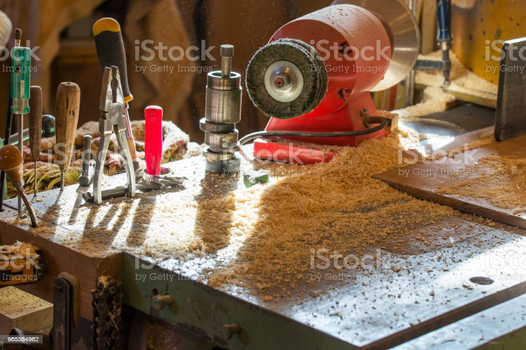 Carpenter tools on wooden table with sawdust zbiór zdjęć royalty-free