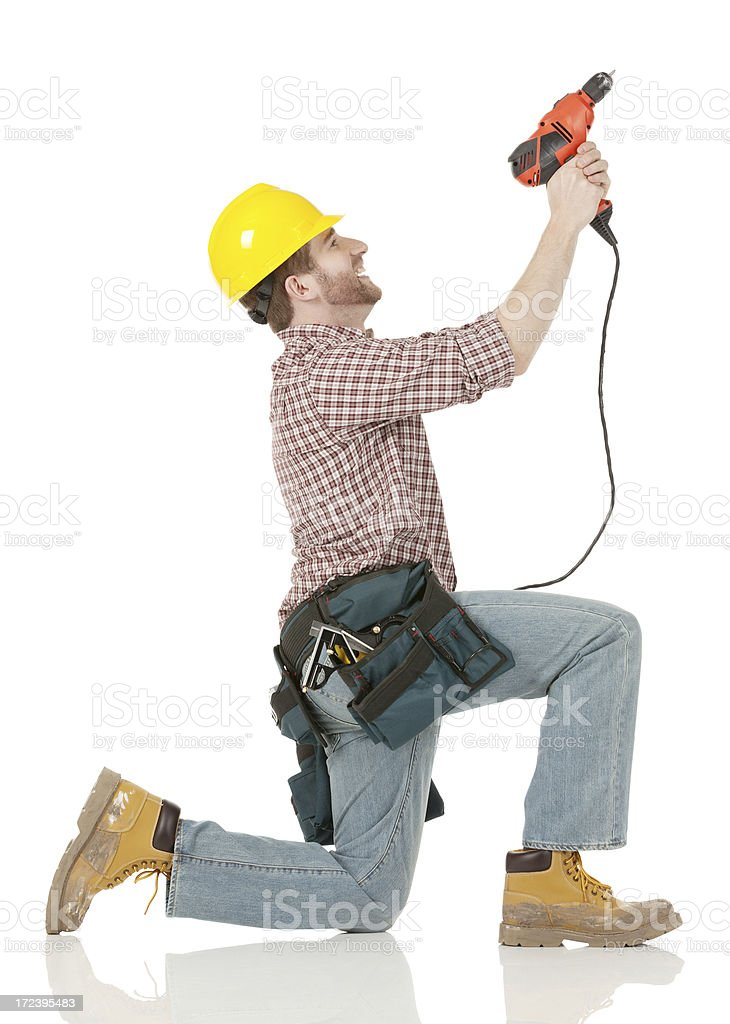 Carpenter using a hand drill royalty-free stock photo