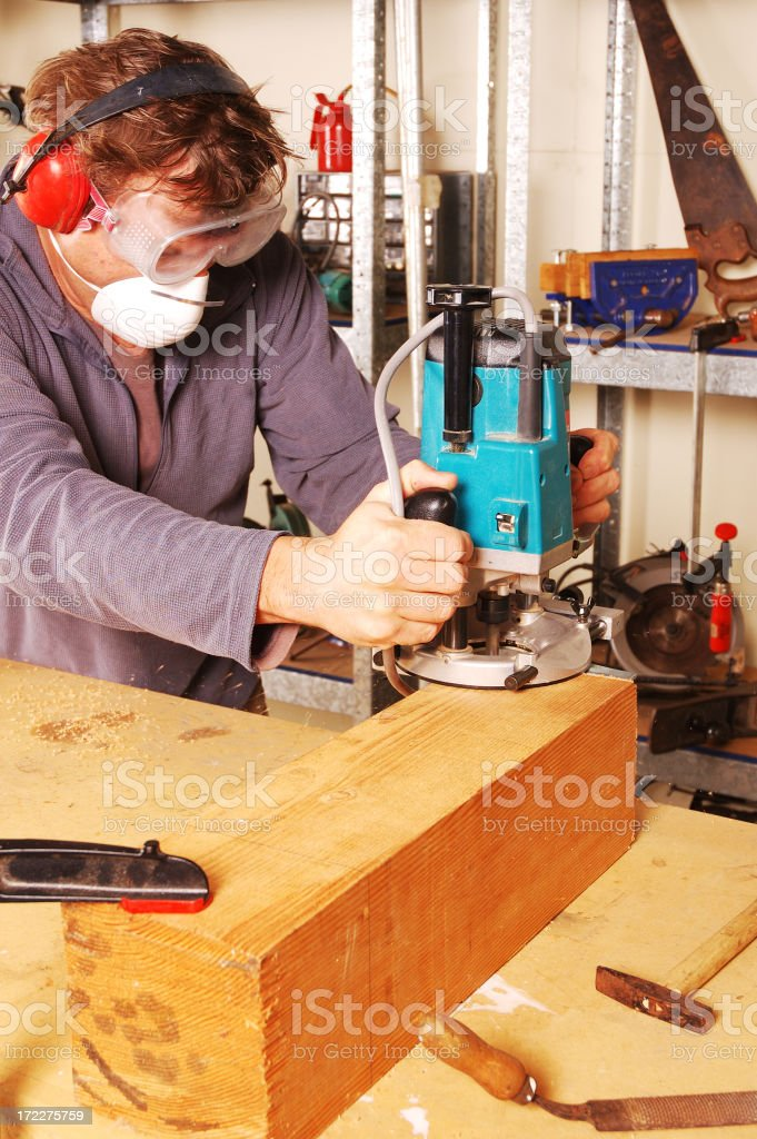 Carpenter using a router royalty-free stock photo