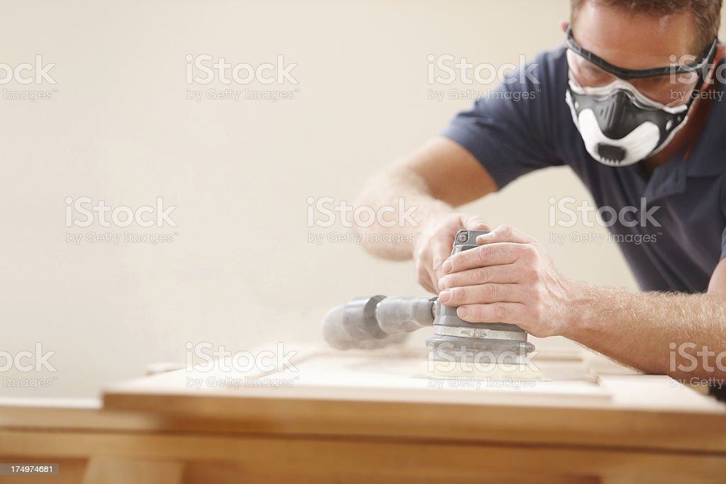 Carpenter using an electric sander stock photo