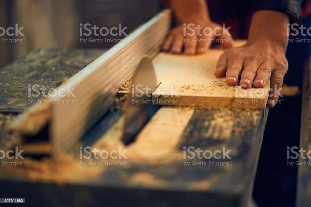 Carpenter using circular saw in workshop stock photo