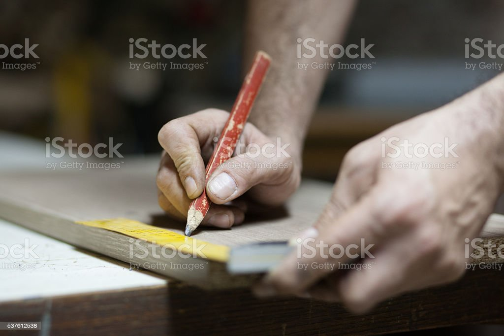 Carpenter using theiInstrument of Measurement and drawing with p stock photo