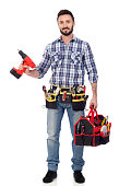 istock Carpenter with toolbox and drill 639364690