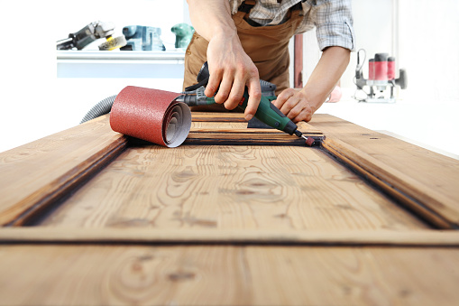1015564946 istock photo carpenter work the wood with the rotary tool 968260118