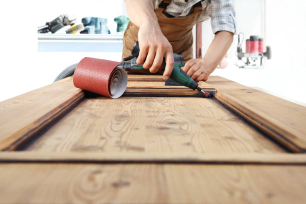 carpenter work the wood with the rotary tool - dremel wood stock photos and pictures
