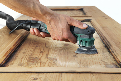 1015564946 istock photo carpenter work the wood with the sander 1015564806