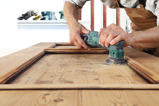 1015564946 istock photo carpenter work the wood with the sander 1015564816
