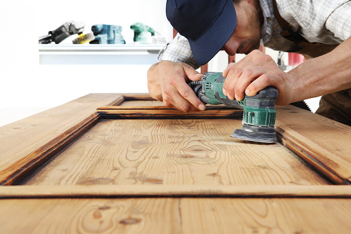 1015564946 istock photo carpenter work the wood with the sander 1015564838