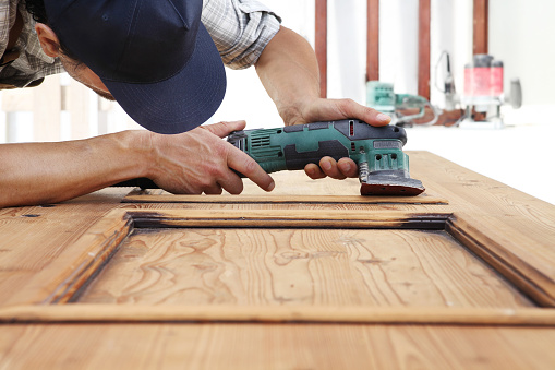 1015564946 istock photo carpenter work the wood with the sander 1029899902