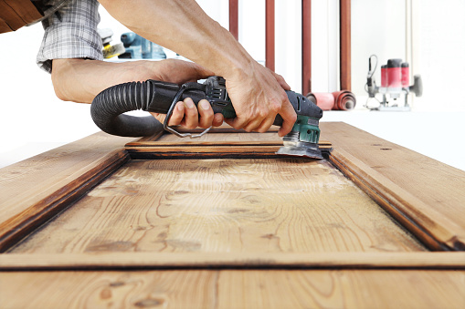 1015564946 istock photo carpenter work the wood with the sander 968260122