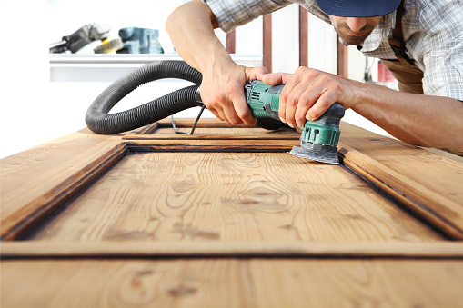 1015564946 istock photo carpenter work the wood with the sander 968260134