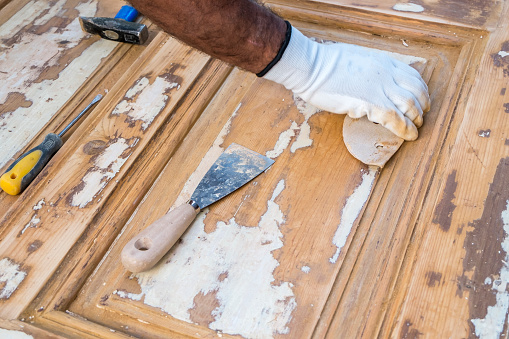 1015564946 istock photo Carpenter work the wood with the sandpaper 1183796807