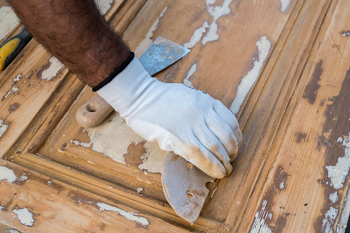 1015564946 istock photo Carpenter work the wood with the sandpaper 1183796842