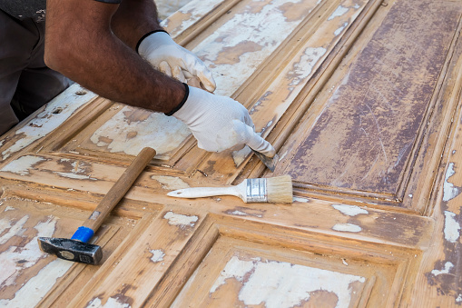 1015564946 istock photo Carpenter work the wood with the sandpaper 1183796898