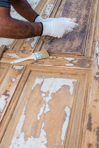 1015564946 istock photo Carpenter work the wood with the sandpaper 1183796950