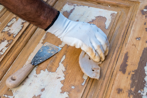1015564946 istock photo Carpenter work the wood with the sandpaper 1187004376