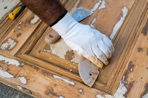 1015564946 istock photo Carpenter work the wood with the sandpaper 1187004391
