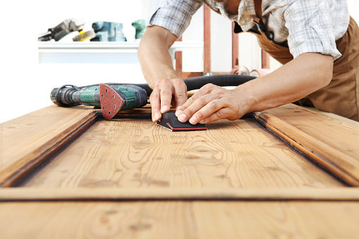 1015564946 istock photo carpenter work the wood with the sandpaper 968260120