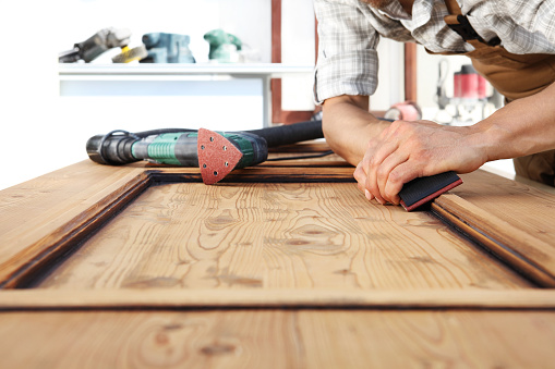 1015564946 istock photo carpenter work the wood with the sandpaper 968260132