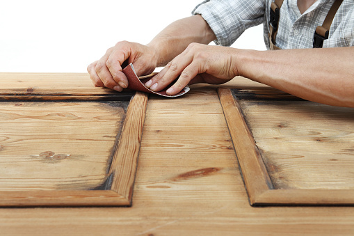 1015564946 istock photo carpenter work the wood with the sandpaper 968260146
