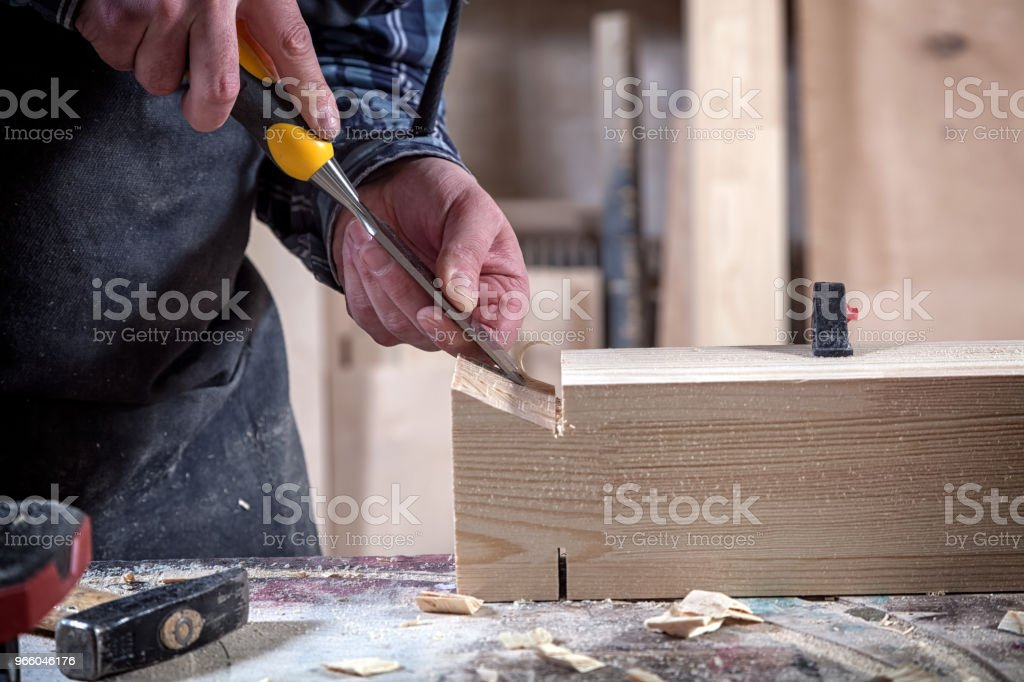 Carpenter  work with wooden - Royalty-free Business Stock Photo